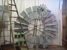 salvaged farm decor (wouldn't that windmill fan make a great mirror frame on a patio?)