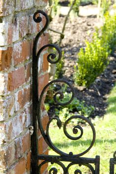 Looking for the right words to describe a gate's anatomy? A gate's vertical bars are called spires or pickets.