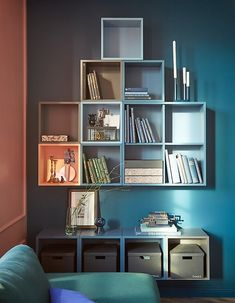 You can make custom wall storage with EKET cabinets from IKEA. This solution mixes shades of blue with grey cabinets and a light orange one for pop. The cabinets are grouped in two with a large space between for a display area and side table. Wall Cabinets Living Room, Ikea Wall Cabinets, Open Cabinets, Living Room Furniture, Gray Cabinets, Wall Storage, Storage Ideas, Storage Solutions, Bedroom Decor