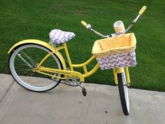I ordered custom bike accessories from Cruzie Suzies on etsy.com. She did such a nice job! Look at how cute the basket liner, seat cover and cup holder are! I LOVE the grey chevron print with the yellow :) Check out her site! She does AWESOME WORK!