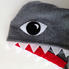 For P's costume, I am going to do it all feltwork on the hood itself. No dangling teeth. Just cut the triangles and attach to the red strip. Then attach the piece as one along the edge on the hood. No fin to bother him either. Pair with jersey sweats. Halloween our way for P :)