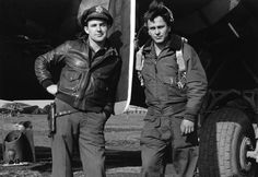 A-2 Jacket (left); B-10 jacket (right). Pilot on the left is wearing his M3 1911 .45 shoulder holster as a belt holster.