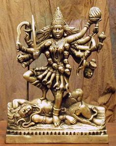 Kali - the four-armed wife of Shiva; carries a trident in one hand, a wielded sword in another, and a severed head, with a bowl beneath to catch the flowing blood. Depicted as black-skinned, with protruding tongue, wearing a garland of human skulls. Kali is associated with death and destruction, and also with time and change. Kali is popular with contemporary feminists in India.