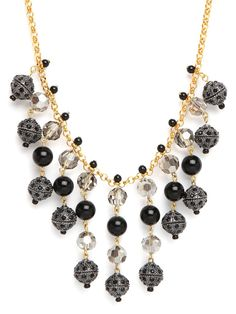 Few necklaces can work both a lavish and pared-down look like this. The gold chains and ample crystal beads, in black and smokey grey, are squarely in the former camp, but it's all executed to clean and simple effect.