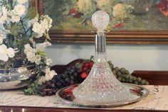 This is a gorgeous crystal Captains style decanter with a silver collar.