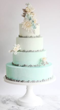 This blue ombre wedding cake by Winifred Kriste Cake is perfect for a Frozen or winter wonderland wedding! Get inspired by more amazing wedding cakes in the feature!