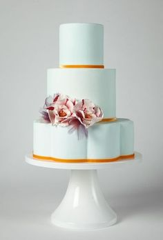 Modern gold-trimmed wedding cake. There's just...something about this that I really like.
