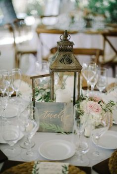 Photographer: John Schnack Photography, Event Design: Très Chic Affairs; Rustic chic vintage gold lantern wedding reception centerpiece;