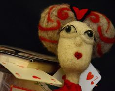 The queen of hearts is an art  doll made of natural Italian Apennines wool and natural fabrics