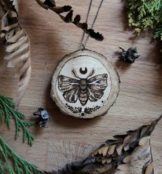 Lunar Moth necklace - Pyrography on wood . Available now in the shop!✨☺ https://www.etsy.com/it/listing/520278645/ciondolo-falena-luna-legno-pirografato