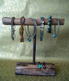 This is the rustic natural look I'm going for! Plus, all the materials are free from my backyard ;) real-wood bracelet display. Maybe add a tier or two and do necklaces too