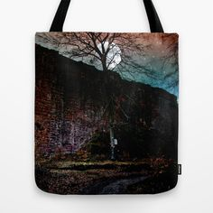 Full moon over a castle ruin Tote Bag A full moon night at a castle ruin in my homeland. This is the big shield wall and the castle ditch.  historical building, tree, stars, neo-mystical, blue, red, shine, light
