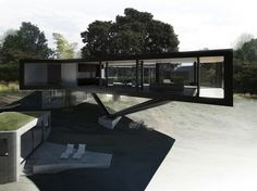 The Napa River House in California is located on a site with mature oak trees and stone pathways winding down a gently sloping hill. Craig Steely Architecture didn't want to disturb the paths and root structure of the trees, so they built a structural system, originally inspired by a chairlift tower, that floats the main living area into the existing oak canopy.