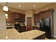 Love the colors of backsplash, granite, and cabinets together