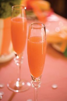 Blushing Mimosas - 37 Spirited Holiday Cocktails - Southernliving. Recipe: Blushing Mimosas  The classic mimosa is equal parts orange juice and Champagne. In this cocktail recipe, pineapple juice and grenadine add a twist of flavor and color. #cocktailrecipes