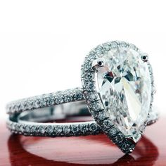 Pave-Set Halo Diamond Engagement Ring Setting.     http://www.dreamstone.com/store/pc/viewPrd.asp?idcategory=324=8676545=1