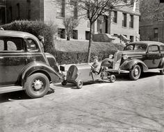 """Nelmobile: March 30, 1937. """"Transportation and no parking worries. Nelm Clark, 16-year old Washington, D.C., youngster, solved this problem by combining a lawn mower motor with a set of motorcycle gears to make this unusual midget auto. Costing $60 to build, the contraption weighs only 150 pounds -- the weight is its main feature -- and if you run out of gas you easily push it or tuck it under your arm and walk home."""" Harris & Ewing Collection glass negative.  Click to view full size."""