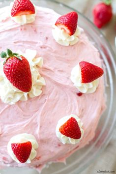 This fluffy vanilla cake is light, airy, and topped with the most amazing, fresh strawberry buttercream! They make perfect cupcakes too!: