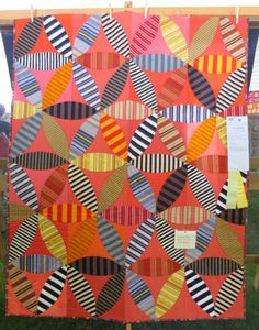 Joseph's Coat of Many Colors, 48″ x 62″,  by Pam Goecke Dinndorf. 2015 Sisters Outdoor Quilt Show.  Photo by First Light Designs.