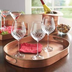 Take your entertaining to a swankier level with our high-quality Copper Trays. They're functional, of course, but are also so beautiful you may wish to display them even when they're not in use. Handmade and given a distinctive patina, no two trays are exactly identical. Durable enough for years of use, and handsome enough to become a treasured family heirloom. Explore other uses besides transporting dishes on top of the dresser, perhaps, to corral your wallet, keys, or jewelry.        ...
