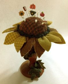 My felted wool candlestick sunflower pin cushion.