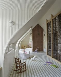 White Kids Room in the Attic with Exposed Brick Chimney - what a beautiful room! Striped Carpets, Striped Walls, Attic Playroom, Attic Rooms, Attic Loft, Playroom Design, Attic Apartment, Kid Rooms, White Kids Room