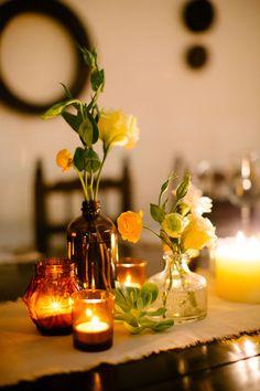 Simple wedding centerpieces with votives and succulents. Studio Mondine.