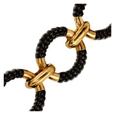 French Onyx & Gold Circle Link Bracelet | From a unique collection of vintage more bracelets at http://www.1stdibs.com/jewelry/bracelets/more-bracelets/