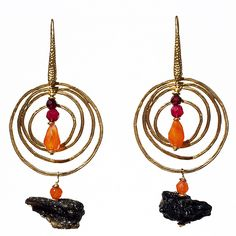 $99 Carnelian Tektite Antagoniste Price: AU$99 (Free worldwide shipping)  These luxurious and bold earrings have been hand-crafted from semi-precious Agates from Brazil, Carnelian and Garnet from India and  Tektite semi-precious  stones from Hong Kong set into a 16 Karat gold plated base from Seoul, South Korea.