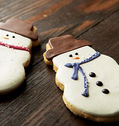 """Frosted Snowman Cookie (Starbucks) (""""A hand-decorated, buttery shortbread cookie topped with white chocolate icing and a milk chocolate hat.)"""