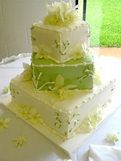 beautiful cake topped with cream orchids