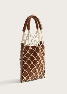 Combined net bag, leather and fishnet bag, brown leather bag with cream color net overlay and leather handles,