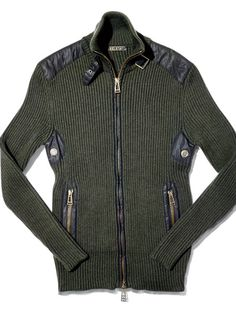 Belstaff. Leather accents and beefy hardware let everyone know that this ain't your average prepped-out cardigan.