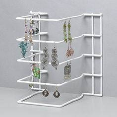 Easy earring display from a kitchen organization rack. Turn it on its side or back to hang earrings from the wire rungs. Tip from Louise Lessing via Bead&Button Magazine