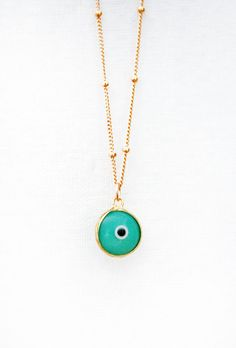 Brush off any negative energy with this cute enamel evil eye necklace. Its the perfect way to add a touch of gold to your outfit with a little