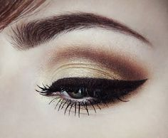 Smoky brown eye with some gold shadow and perfect wing. Great classy look. LOVE