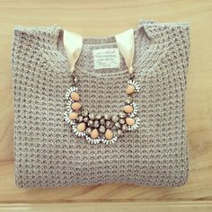 Waffel sweater with a bauble necklace.