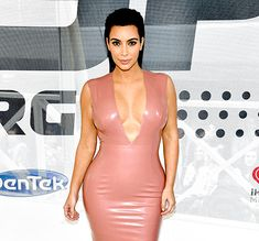 Kim Kardashian showed off her curves in this latex dress.