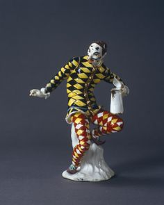 Meissen porcelain figure of harlequin with a jug by J J Kaendler c1738, in the porcelain room at Fenton House, London.......Saw this today on TV's Bargain Hunt......amazing figurine!!