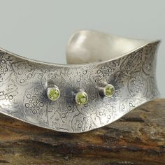 Etched photo with peridots - photo and metalwork by Raminta Jautokas   | Flickr - Photo Sharing!