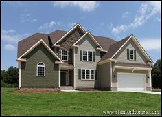 Custom home with stone and shake accents. Custom Home Builder Raleigh.