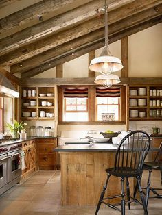 A wooden kitchen design is timeless, rustic and oh-so-charming in any country cabin.