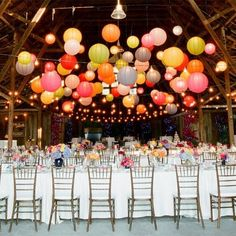 We love the glow from paper lanterns at a wedding reception.