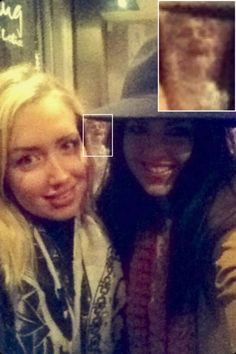 GHOST PHOTO BOMB OR MATRIX?! Two friends were simply trying to take a selfie when they unintentionally included a paranormal extra. The girls claim they were photobombed by a 'ghost'. After flashing their best smiles in the 'virtually empty' Slug and Lettuce, pals Victoria Greeves, 22, and Kayley Atkinson, 23, were horrified to see the spooky being stood behind them. 'It is so clear, and it looks like what can only be described as a Victorian woman, laughing behind us,' said Victoria.