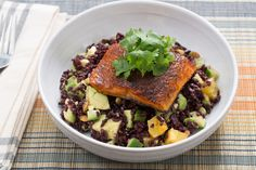 Mexican Spiced Salmon with Black Rice, Avocado & Orange Salad . Visit https://www.blueapron.com/ to receive the ingredients.