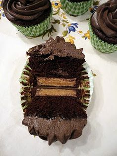 Peanut Butter Cup Cupcakes  must...make...these...now..  Site has dozens of great cupcake recipes (52 cupcakes and layla)