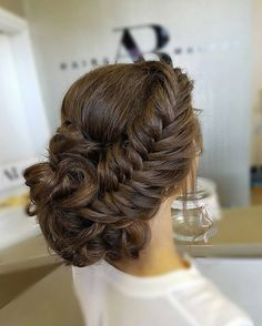 Bridal fishtail updo by Doni