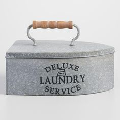 """Keep your laundry room trim and tidy with our iron-shaped box. Fitted with a wood-handled lid and stamped with the words """"deluxe laundry service,"""" it's a charming solution for storing stray buttons or sewing supplies."""