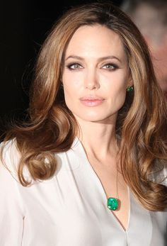 Angelina Jolie wearing her own emerald jewelry at the 77th Annual New York Film Critics Circle Awards Gala