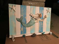 This weekend we made this plaque again using pallet wood that we painted then distressed and knobs/shells/mermaid from Michael's & Hobby Lobby.